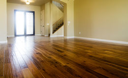Hardwood flooring in new home. New home with beautiful hardwood flooring in living room area royalty free stock photos