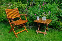 Hardwood garden chair and table Royalty Free Stock Photography