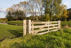 Hardwood gate between wooden posts in a rural area Stock Photography