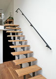 Hardwood stairs in modern living room Stock Photos