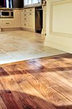 Hardwood  and tile floor. Hardwood and tile floor in residential home kitchen and dining room Stock Photography