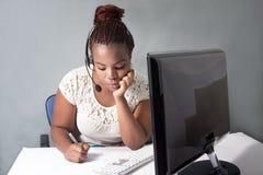 Hardwording call center agent at work Stock Photos