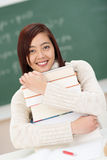 Hardworking beautiful young Asian student Royalty Free Stock Photo
