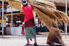 Hardworking devotees at the temples of UBUD stock photography
