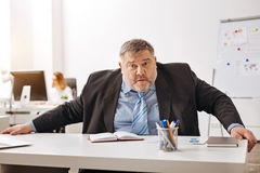 Hardworking distressed employee looking confused Royalty Free Stock Photos