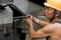 Hardworking laborer Stock Images