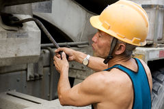 Hardworking laborer. On construction site royalty free stock image
