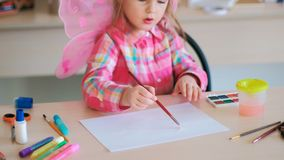 Hardworking little cutie girl art lessons. Hardworking little cutie on art lessons. creative process. lifestyle of talented people Royalty Free Stock Image