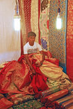 Hardworking Merchant selling Traditional Fabric Royalty Free Stock Images