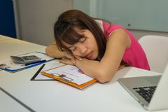 Hardworking office employee sleeping in office. Hardworking office employee sleeping in her office Royalty Free Stock Photo
