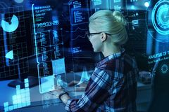 Hardworking programmer analyzing the statistics of cyber attacks. Processing information. Smart experienced enthusiastic programmer feeling interested while Stock Images