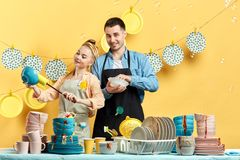 Hardworking young people is ready to help you to clean your kitchen royalty free stock images