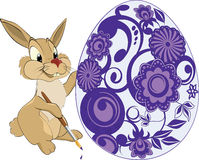 Hare and an Easter egg.Cartoon Stock Image