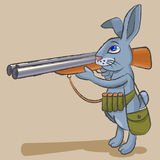 Hare -  hunter. The cheerful hare holds big a hunting rifle and is going to shoot Royalty Free Stock Photos