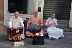 Hare Krishna. Devotees with interesting musical instruments singing Hare Krishna on the street of Ljubljana, Slovenia. Photo taken on May 19, 2011 royalty free stock photo