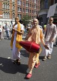 Hare Krishna crossing raod. Hare Krishna group crossing the road in London Stock Photo