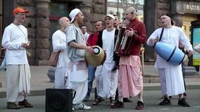 Hare Krishna devotees playing musical instruments, dancing and singing stock footage