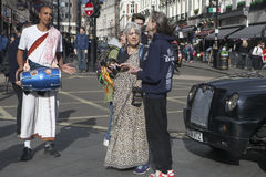 Hare Krishna Devotees walk in the street in London, UK Stock Photography
