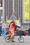 Hare Krishna on foldable bicycle at Dam Square, Amsterdam, Netherlands Stock Photos