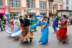 Hare Krishna girls in Moscow. Hare Krishna devotees in Moscow, walking street Arbat in the city center Stock Photos