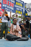 Hare Krishna meditating between Christians protest in the 37th Annual Festival of the Chariots Stock Images