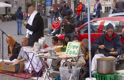 Hare Krishna members singing and playing in the streetwith sign offering free food. Stock photo royalty free stock image