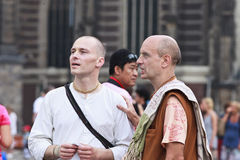 Hare Krishna's in Amsterdam. AMSTERDAM-AUG. 19, 2012. Hare Krishna's on Aug. 19, 2012 in Amsterdam. Hare Krishna is a religious movement based on traditional Stock Photography