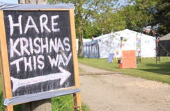 Hare Krishna sign. This way for Hare Krishna sign at an outdoor summer festival Royalty Free Stock Photography