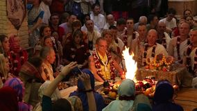 Hare Krishna sing mantra at the ceremony stock footage