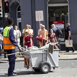 Hare Krishna and Sweeper. Hare Krishna and road Sweeper in London Royalty Free Stock Photos