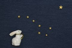 Hare looks at the starry sky flat lay Stock Image