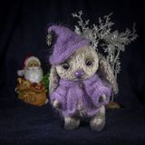 A doll of a hare in purple knitted clothes waiting for Santa Claus. A hare in purple knitted clothes waiting for Santa Claus Stock Photo