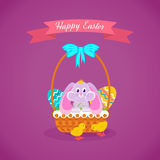 Hare sitting in basket to Easter eggs, birds running alongside. Royalty Free Stock Photos