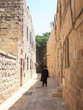 Haredi Man walking in the Jewish Quarter Stock Photos