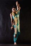Harem girl. Dancer in Arabian costume does vertical splits royalty free stock photos