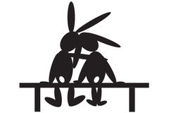 Hares At The Bench. Royalty Free Stock Photo