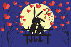Hares at the bench. Hares at the bench in night Royalty Free Stock Photos