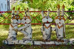Hares from the birch logs. figure of wood in garden on a summer day stock image