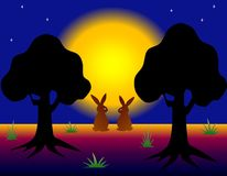 Hares in the dark night forest. View of a pair of hares in the dark night forest on the background of the full yellow shining moon on the starry sky Stock Images