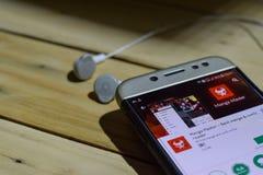 Harga Mobil Baru bärare-applikation på den Smartphone skärmen Manga Master bärare-applikation på den Smartphone skärmen Royaltyfri Foto