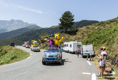 Haribo Caravan in Pyrenees Mountains - Tour de France 2015. Col D'Aspin,France- July 15,2015: Haribo Caravan during the passing of the Publicity Caravan on the royalty free stock photography