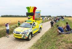 Haribo-Fahrzeug auf einem Kopfstein-Straßen-Tour de France 2015 Stockfoto