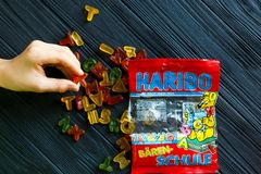 Haribo jelly pack on dark wooden table. Haribo is a German confectionery company royalty free stock photos