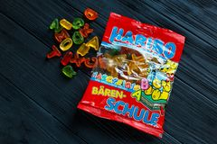 Haribo jelly pack on dark wooden table. stock photo