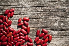 Haricot. Red beans on a wooden board stock photo