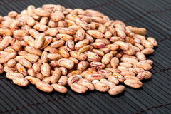 Haricot beans. Pink haricot beans on the dark Royalty Free Stock Photo