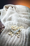 Haricot beans in bowl and texture of wool Stock Photos