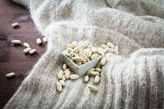 Haricot beans in bowl and texture of wool Stock Photography
