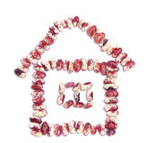 Haricot beans in the shape of a house on white Stock Photo