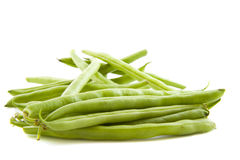 Haricot vert. Green beans on a pile isolated over white stock images